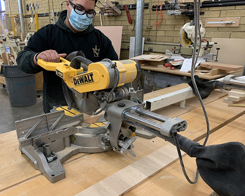 Student using woodworking tools