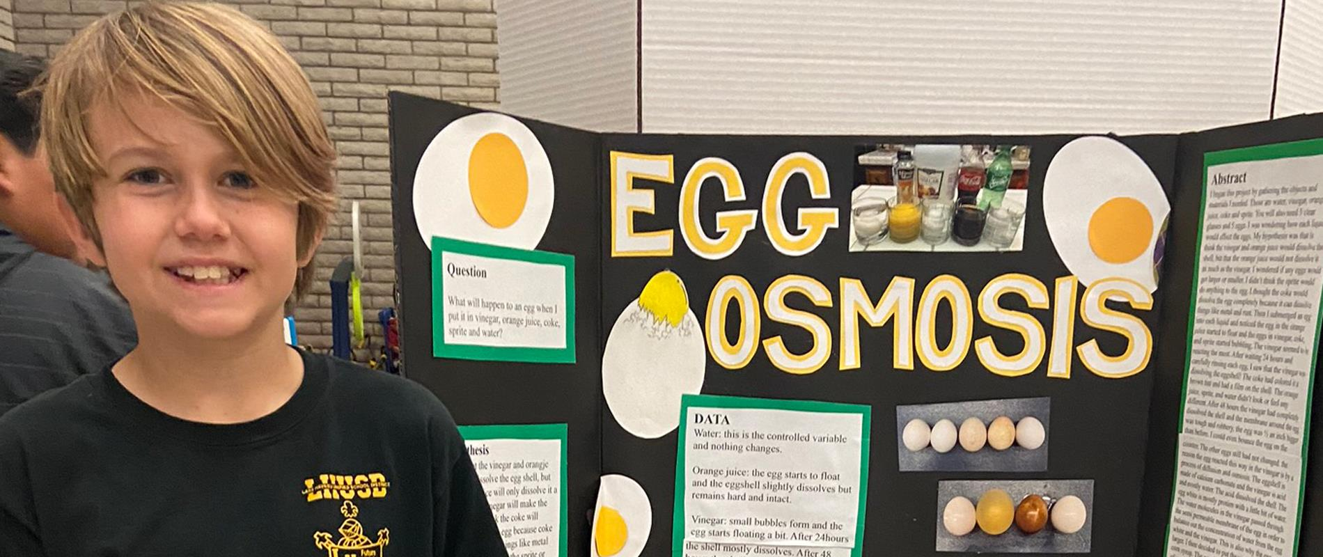 picture of student with science fair project
