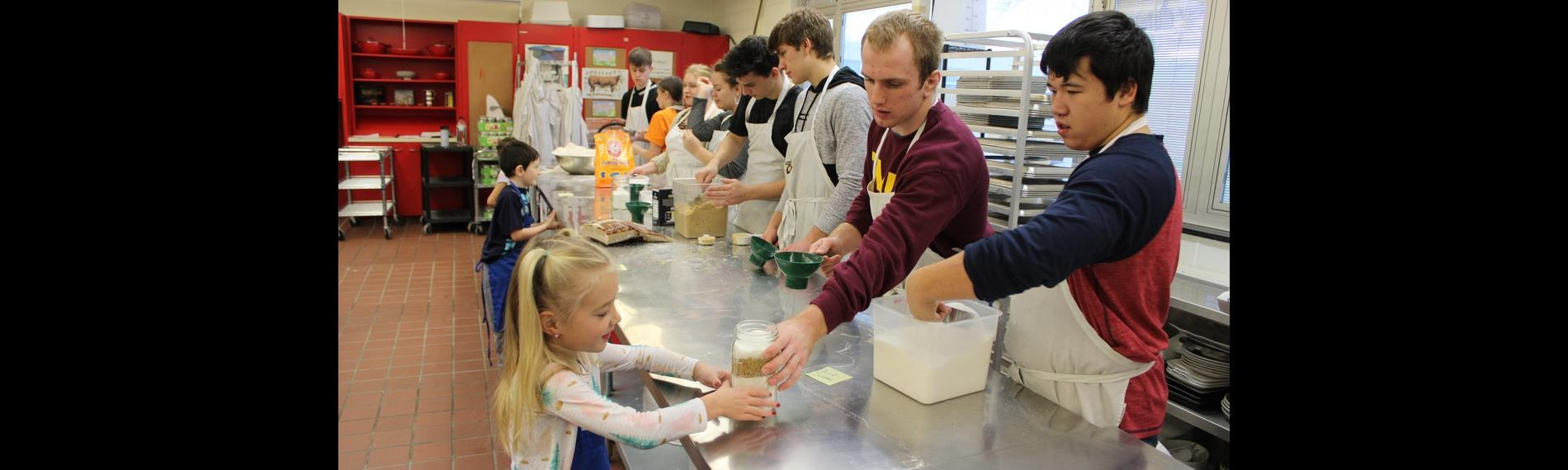 Elementary Students cooking with OHS Students