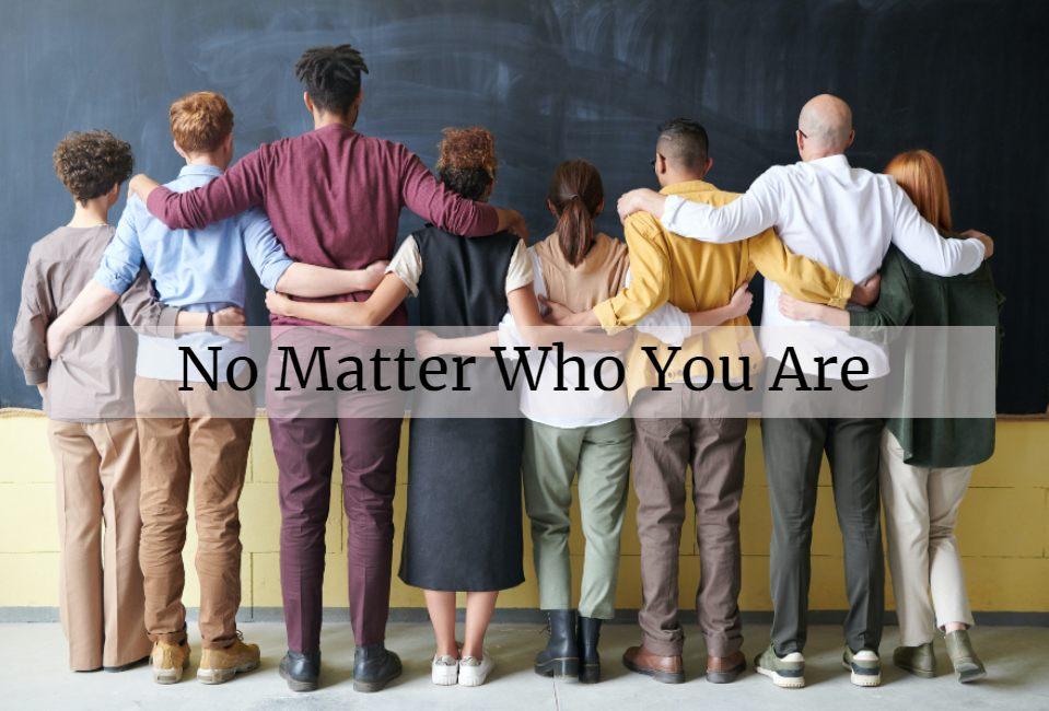 people standing shoulder to shoulder with hands behind back