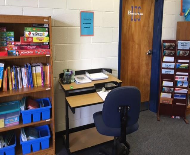 parenting center picture of desk, books, and games