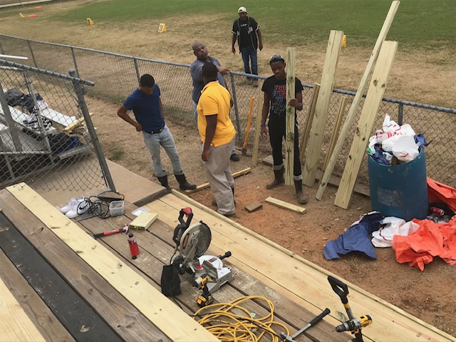 Students working on football stands
