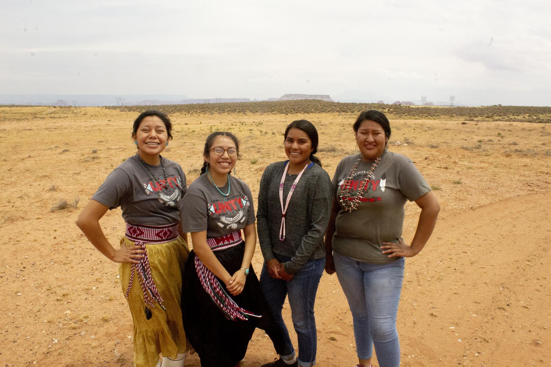 Navajo students wearing traditional clothing.