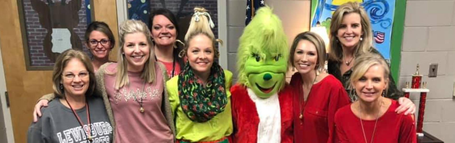 Group of ladies with the Grinch for Christmas