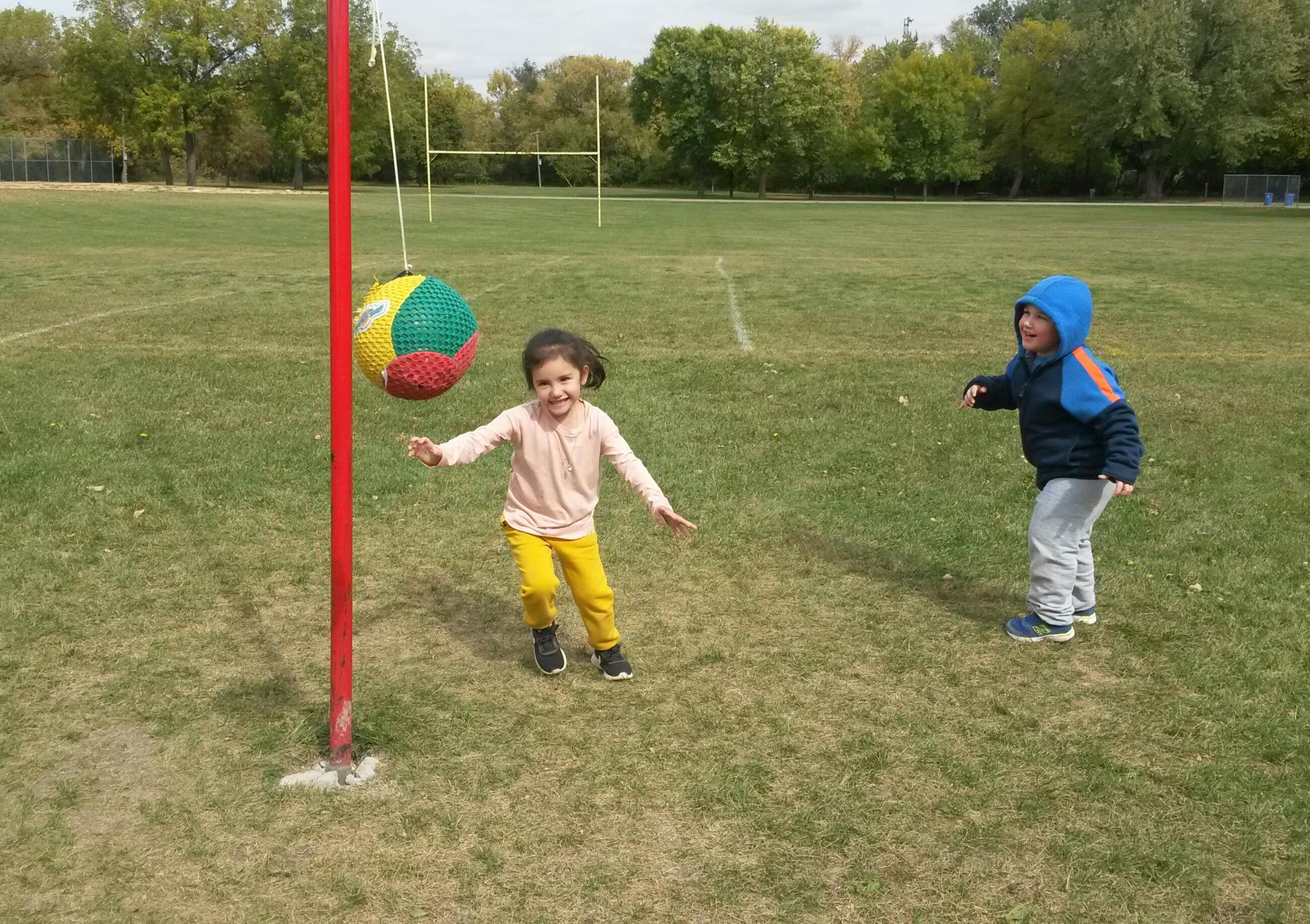 Two Children Playing Tetherball