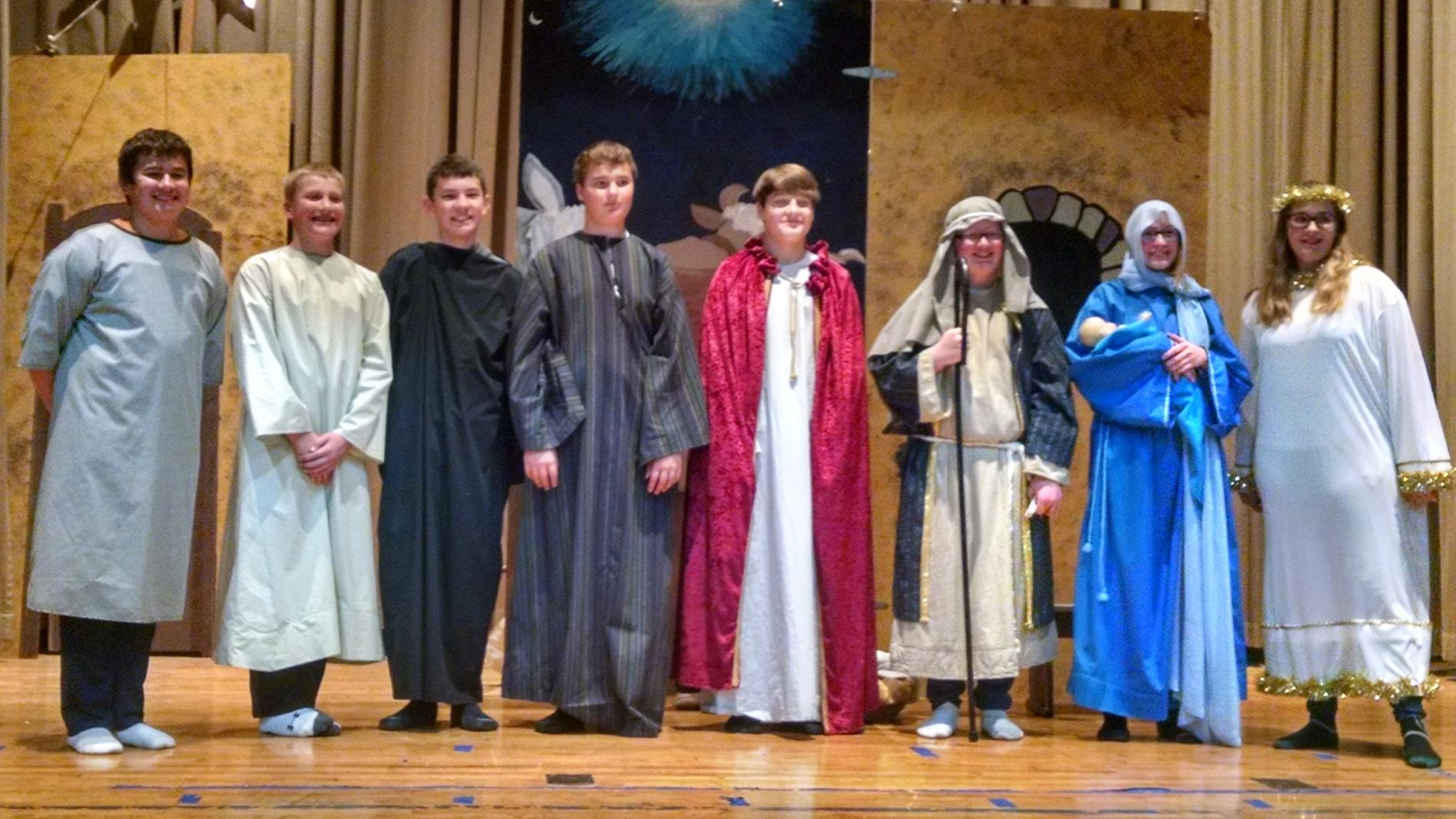 7th and 8th Grade Students Posing for Picture in Nativity Costumes