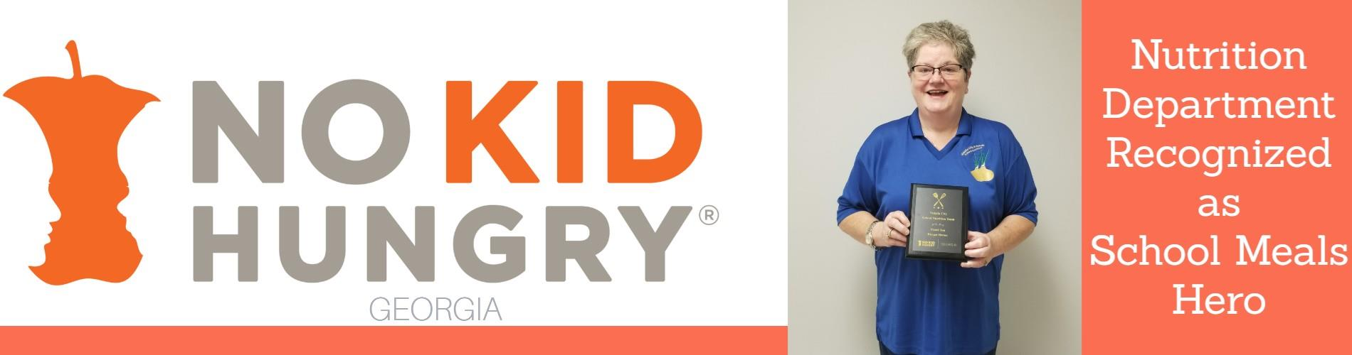 Denise Parson Holding No Kid Hungry Plaque
