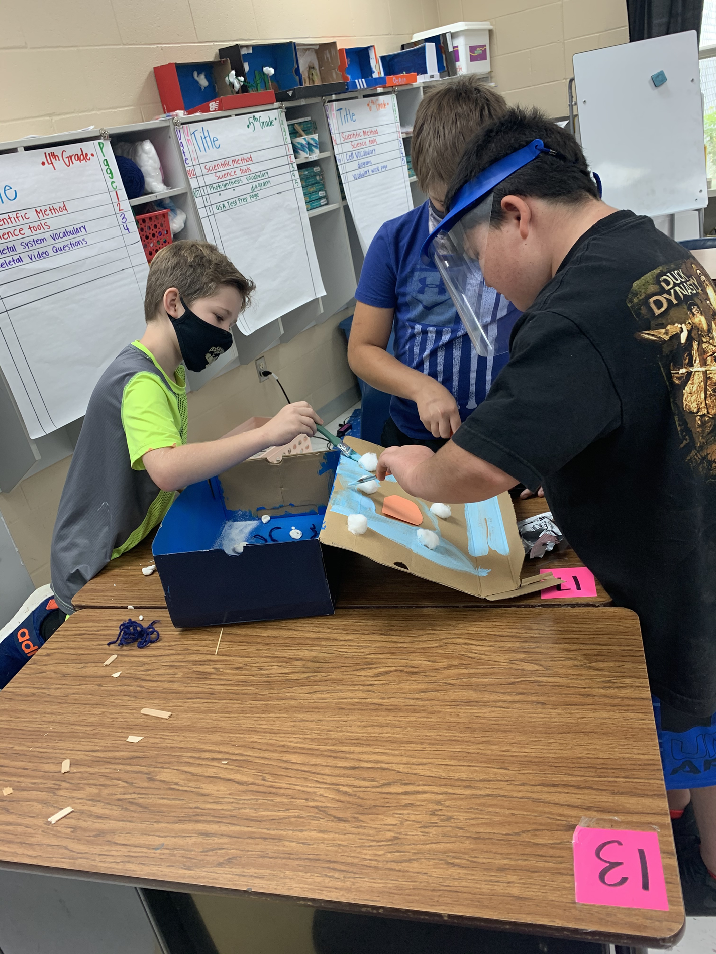Easton, Conner, and Caleb working hard on their ecosystem design.