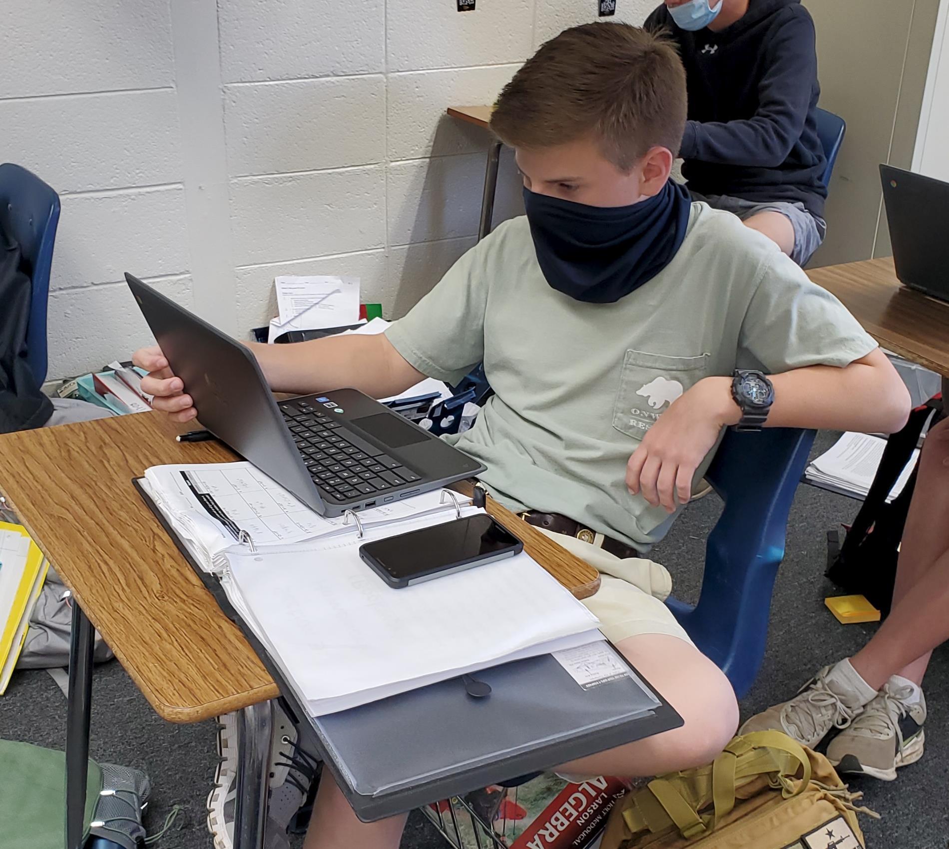 Student using new chromebook