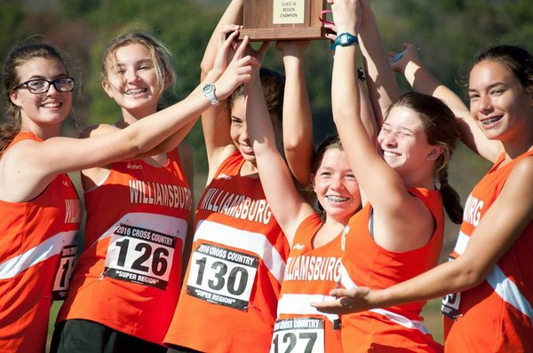 Cross Country Team Holding up a trophy