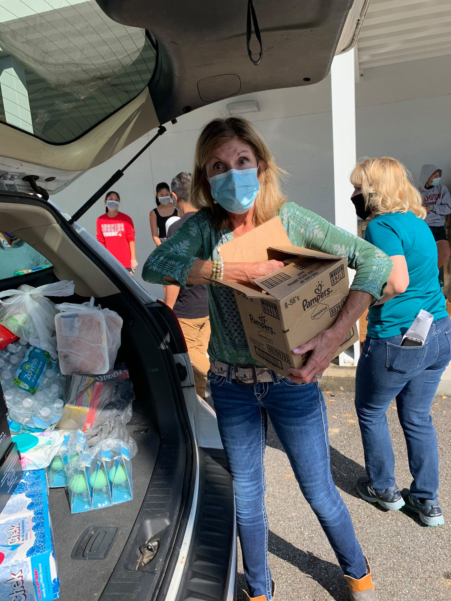 Packing a Car with Food Drop Items