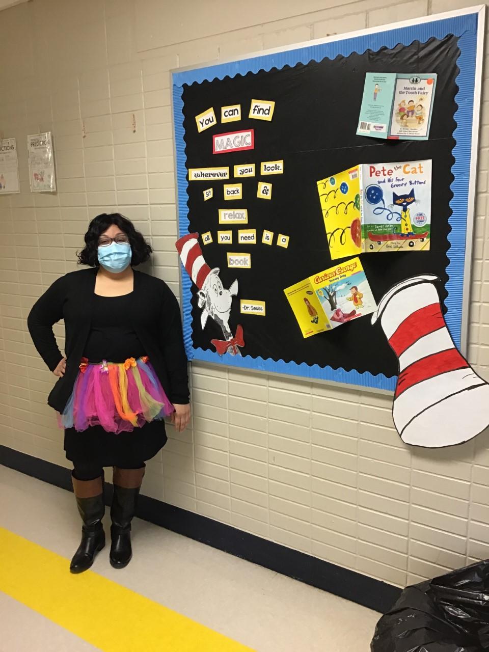 Teacher with bulletin board
