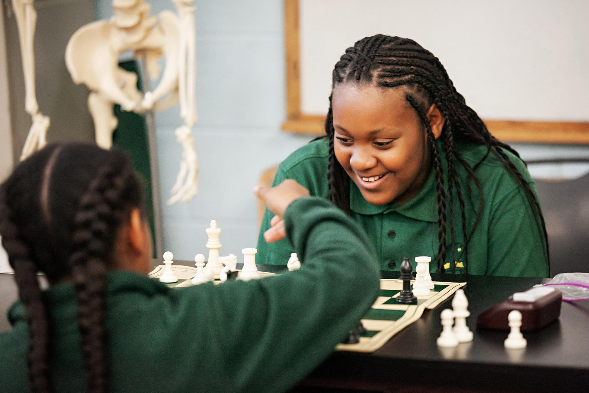 Female student playing chess