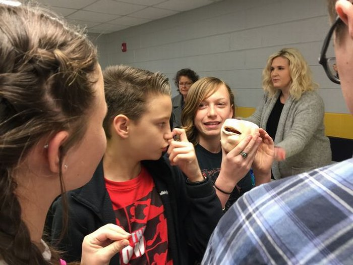 DWS students seeing the effects of chewing tobacco.