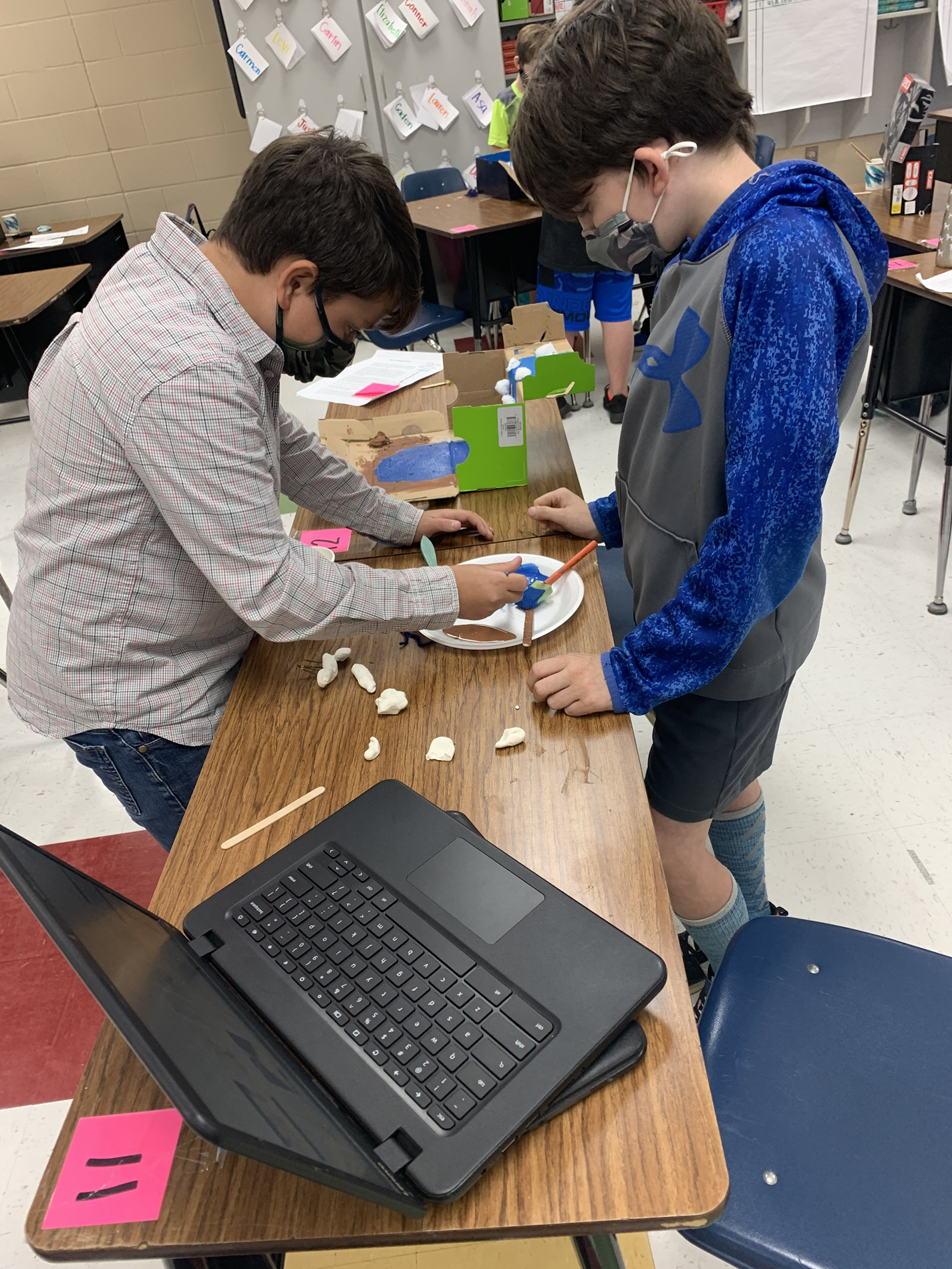 Justin and JC make sure their clay models fit their environment.