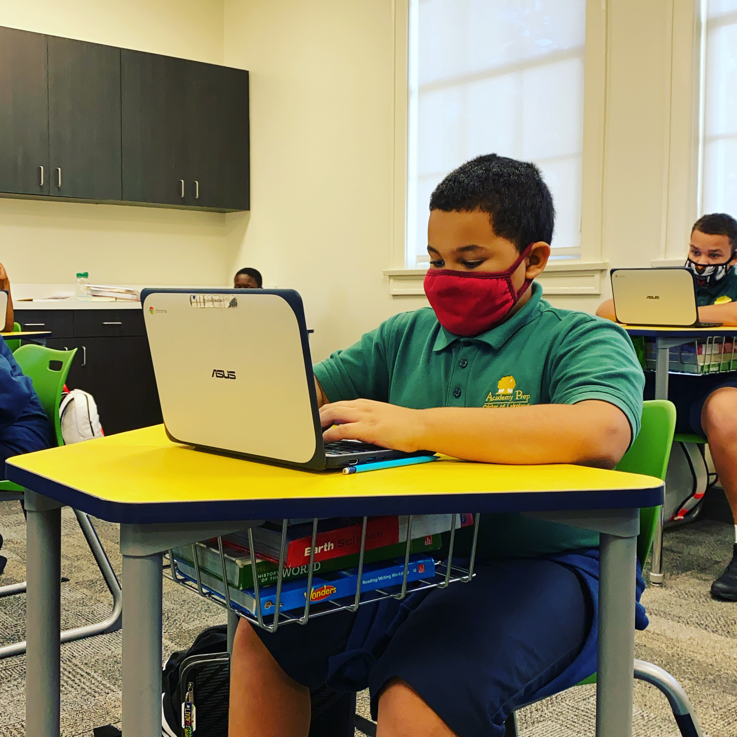 student on a chromebook