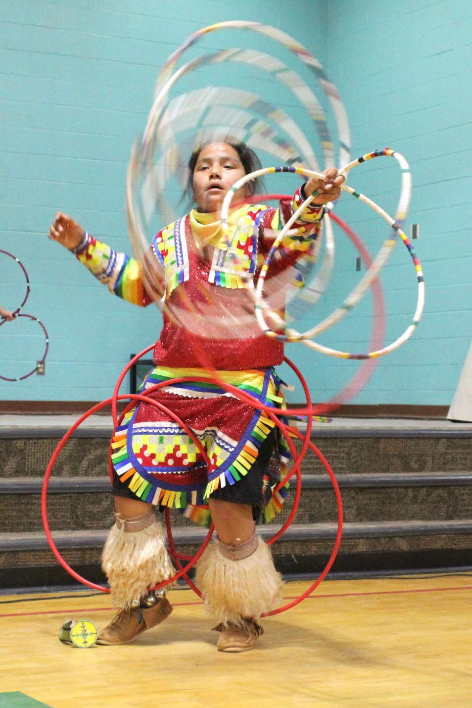 A Navajo student performing a hoop dance.