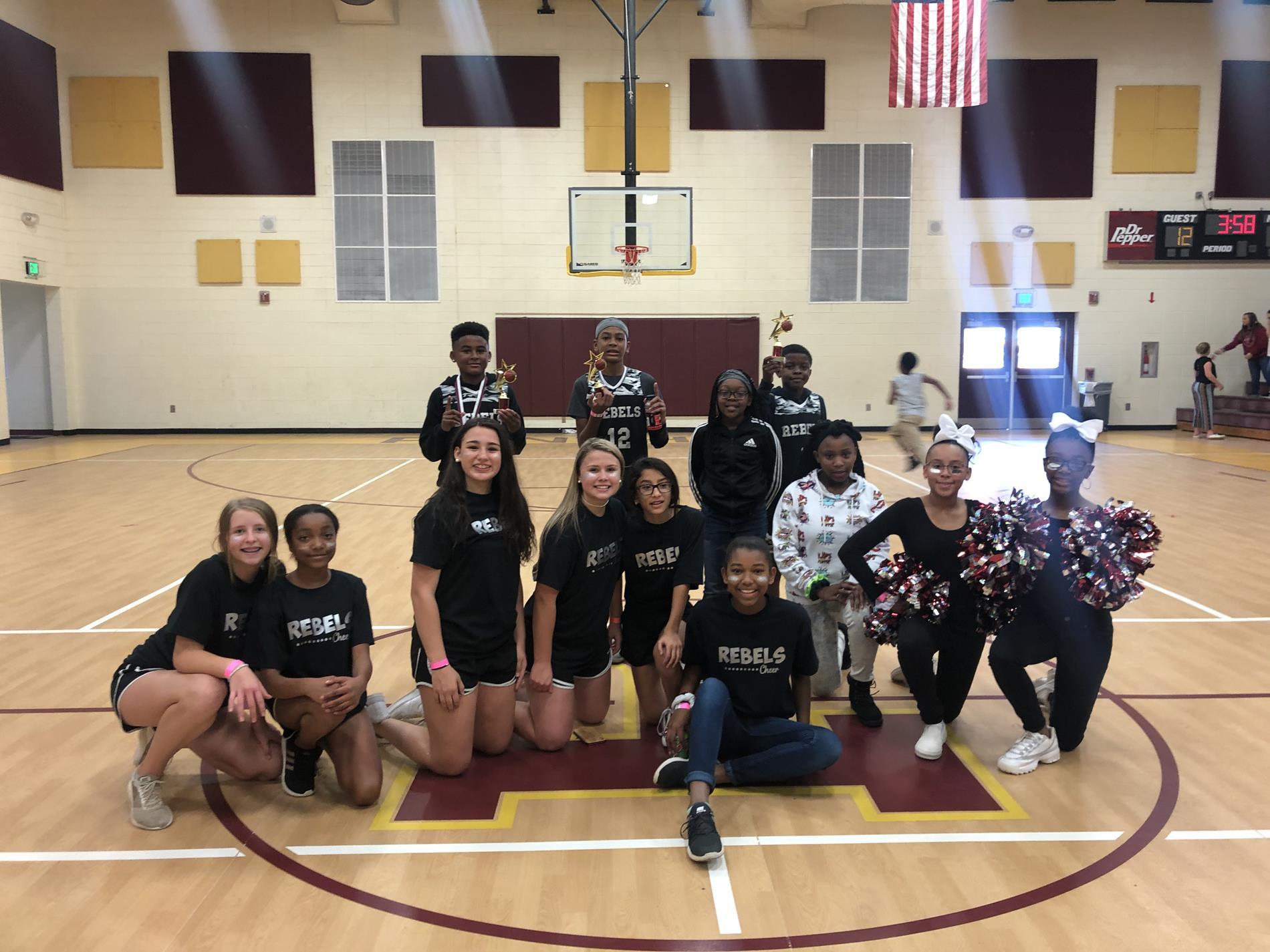 TSA Basketball Team with TSA Cheerleaders
