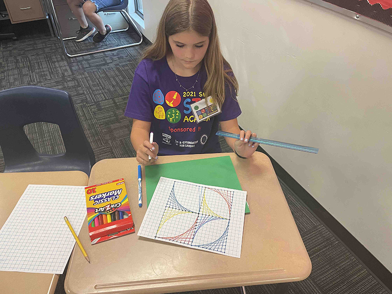 girl working on project at STEM Academy