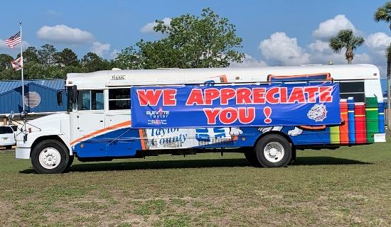 School bus with We Appreciate You Banner