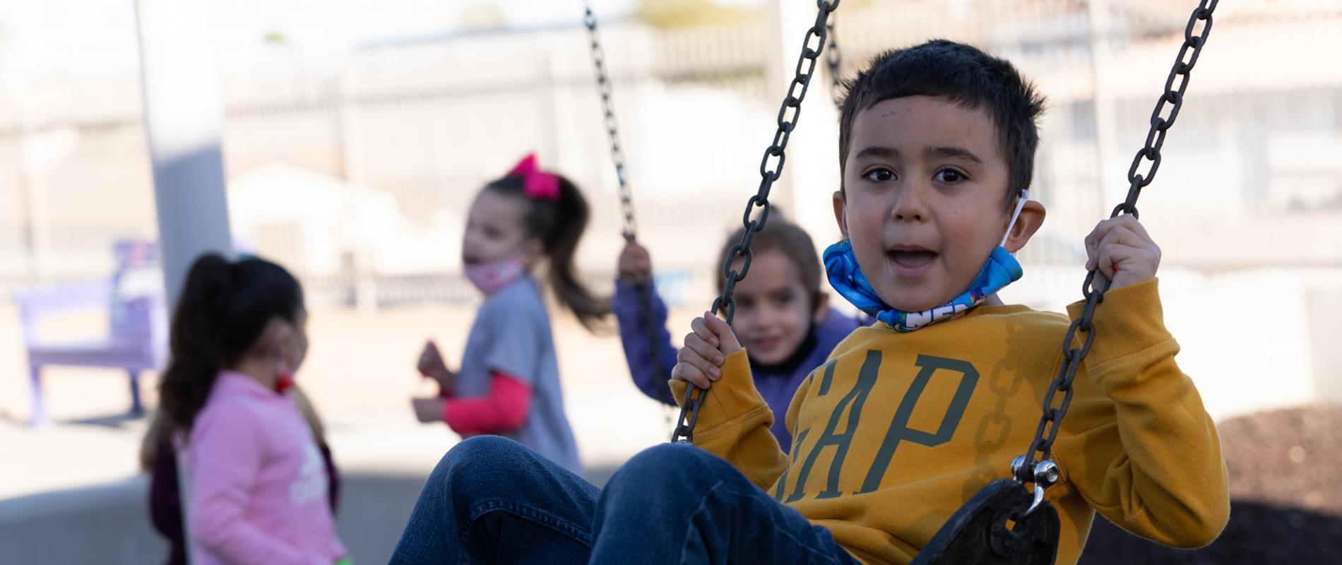 kids swinging on new playground
