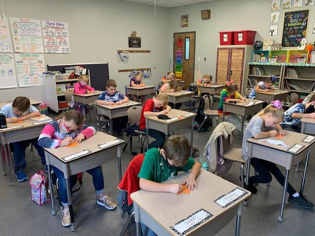 Mrs. Erin's Class scratching for phonics!