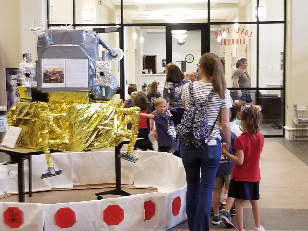 Spanish Fort Elementary School field trip students enchanted by the finished Lunar module in the library foyer