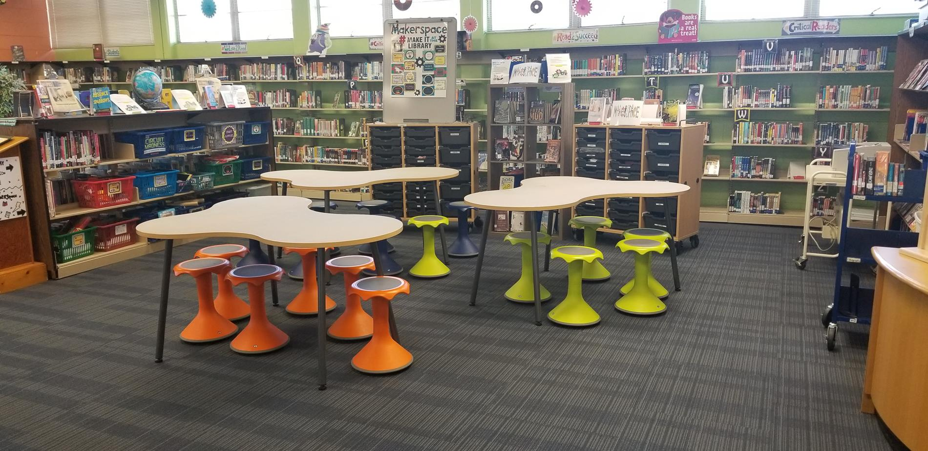 Makerspace area with tables and wobble stools