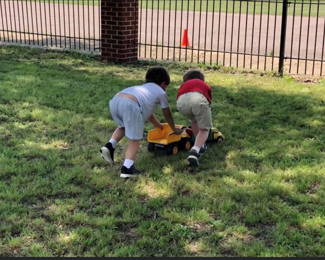 boys pushing truck