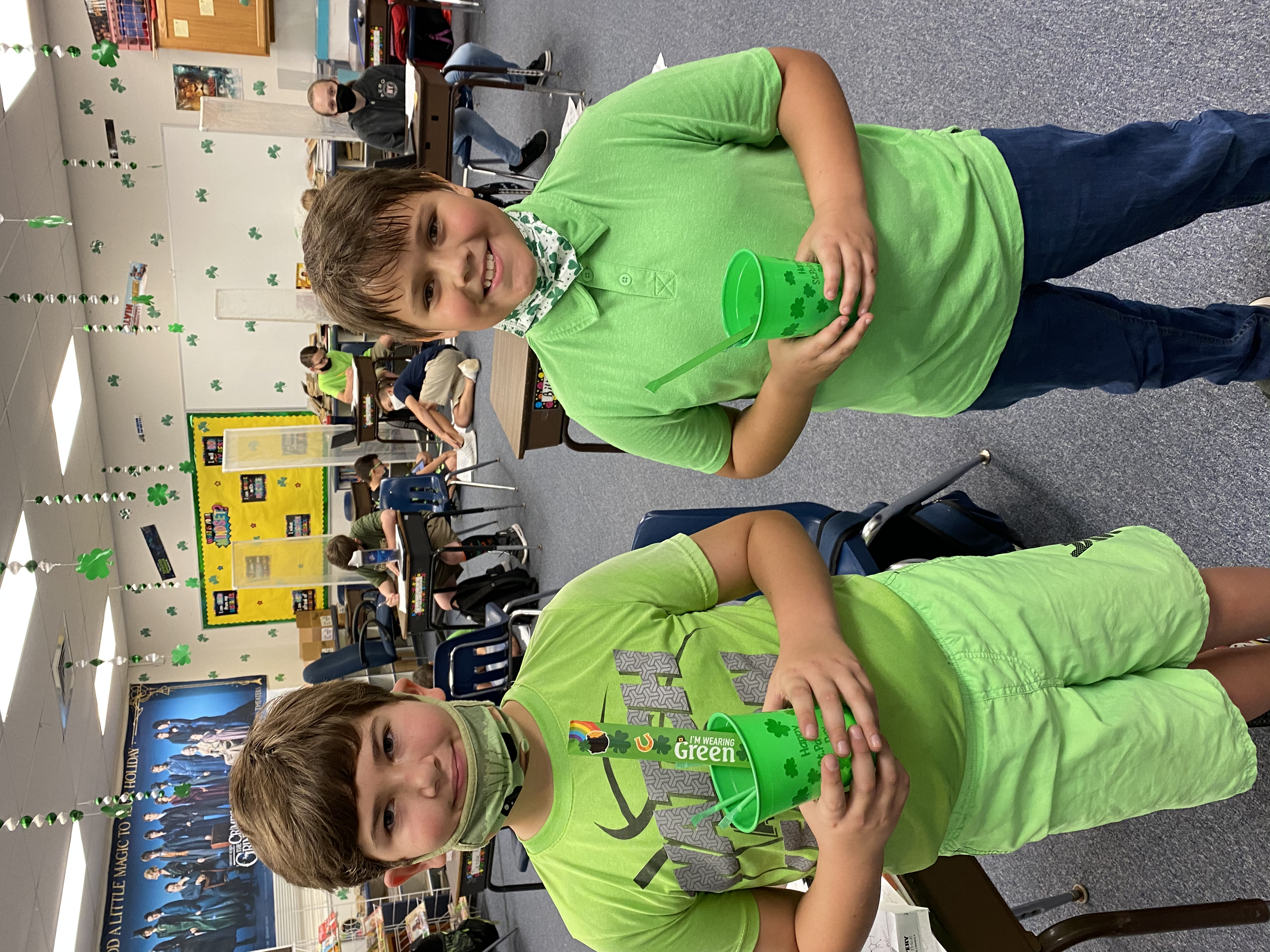 Two 5th grade students showing off their prizes for completing the Escape Rooms.