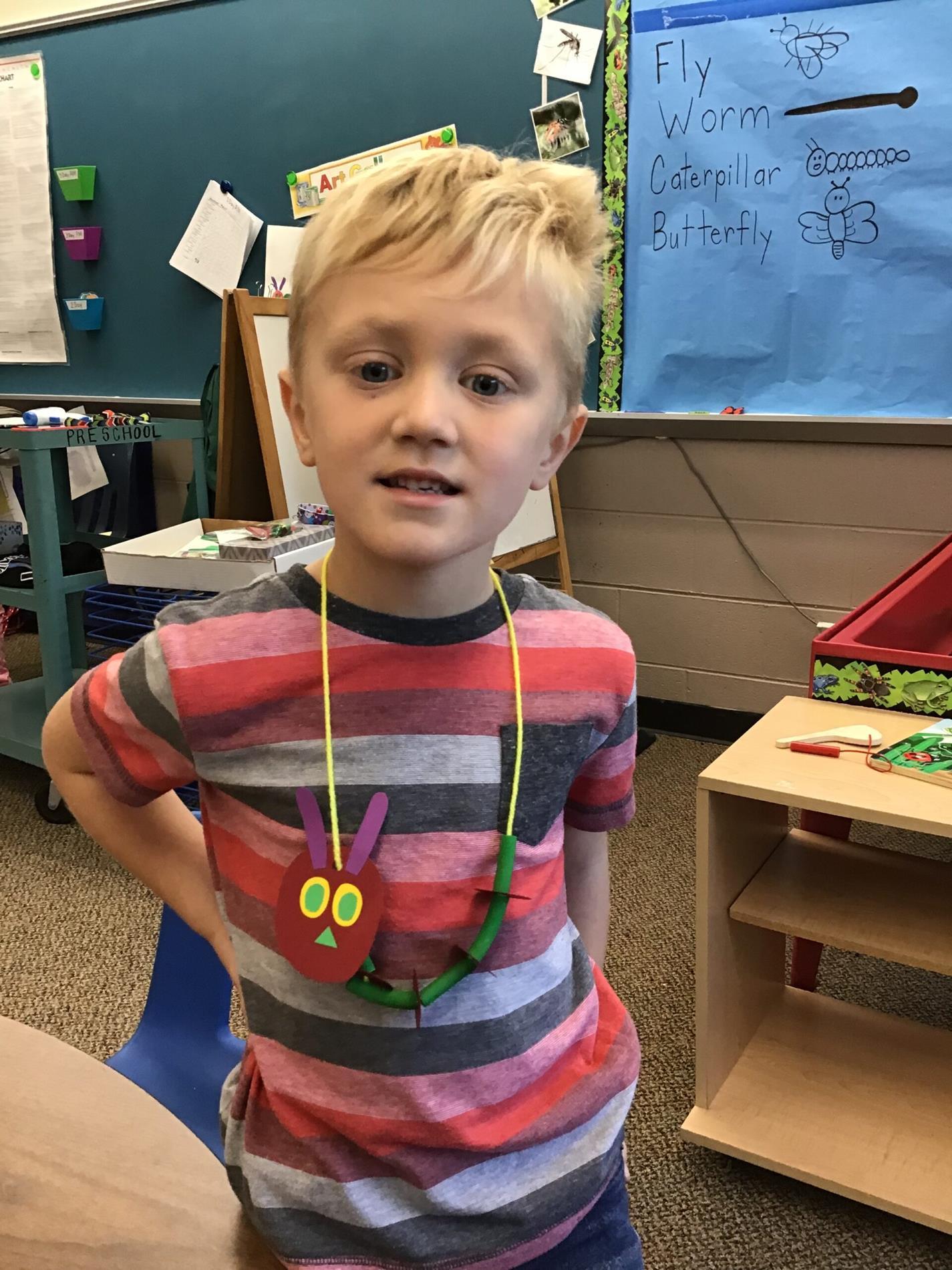 boy wearing necklace art