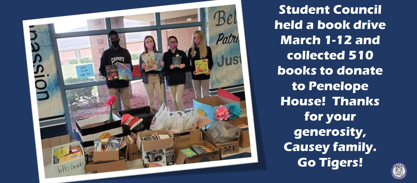 Student council with books from book drive