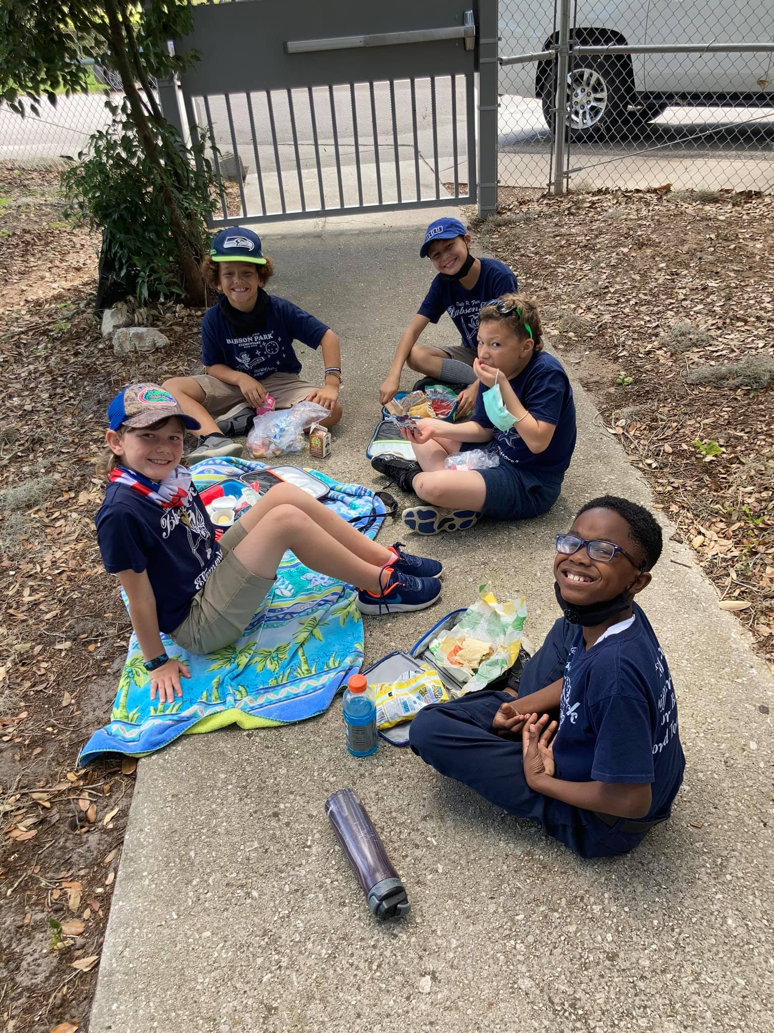 Students enjoying their picnic lunch.