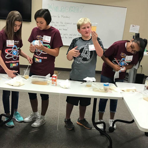 Students work on experiment during STEM academy