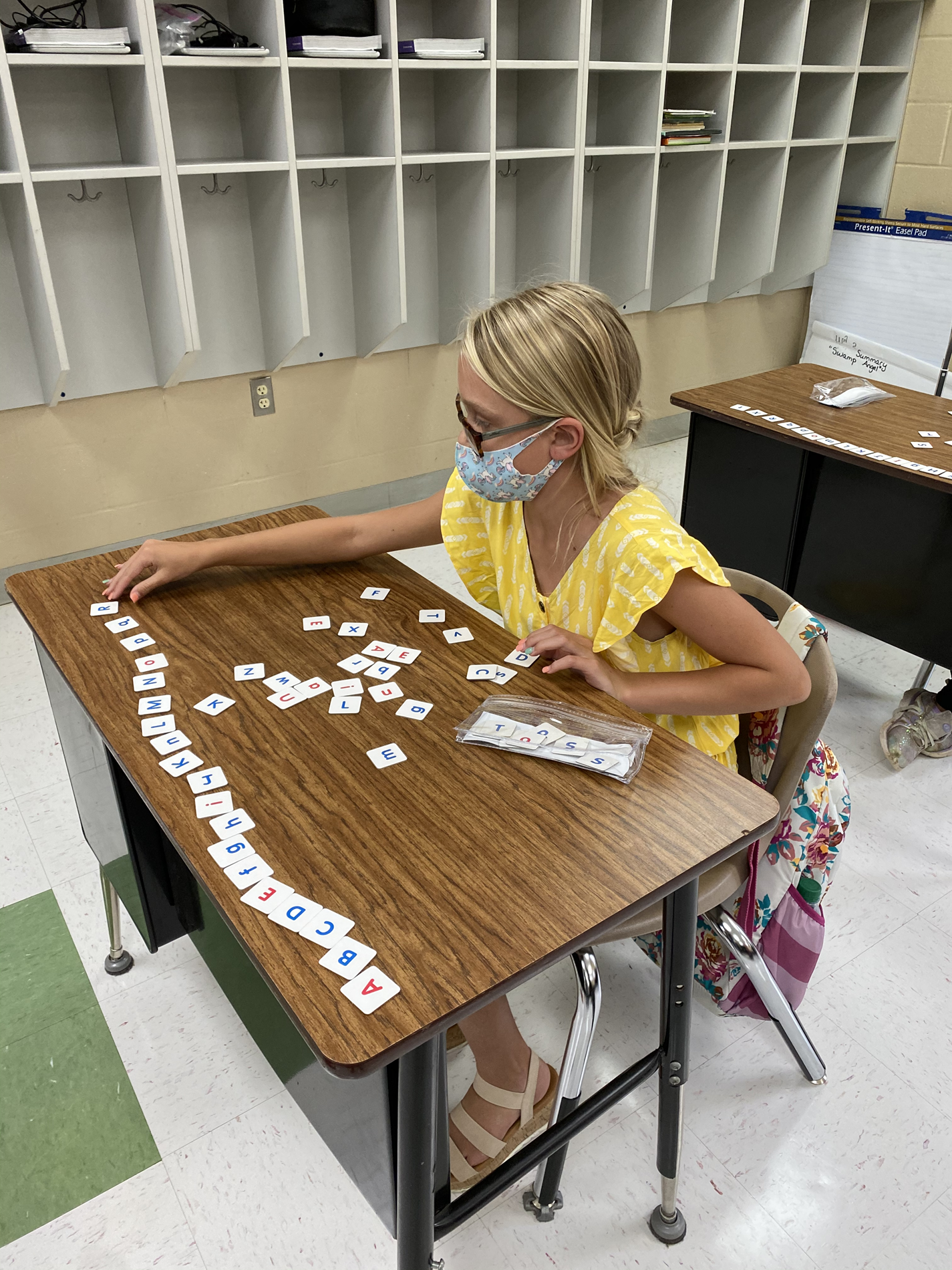 Chloe sets up her area to prepare for the phonics lesson of the day!