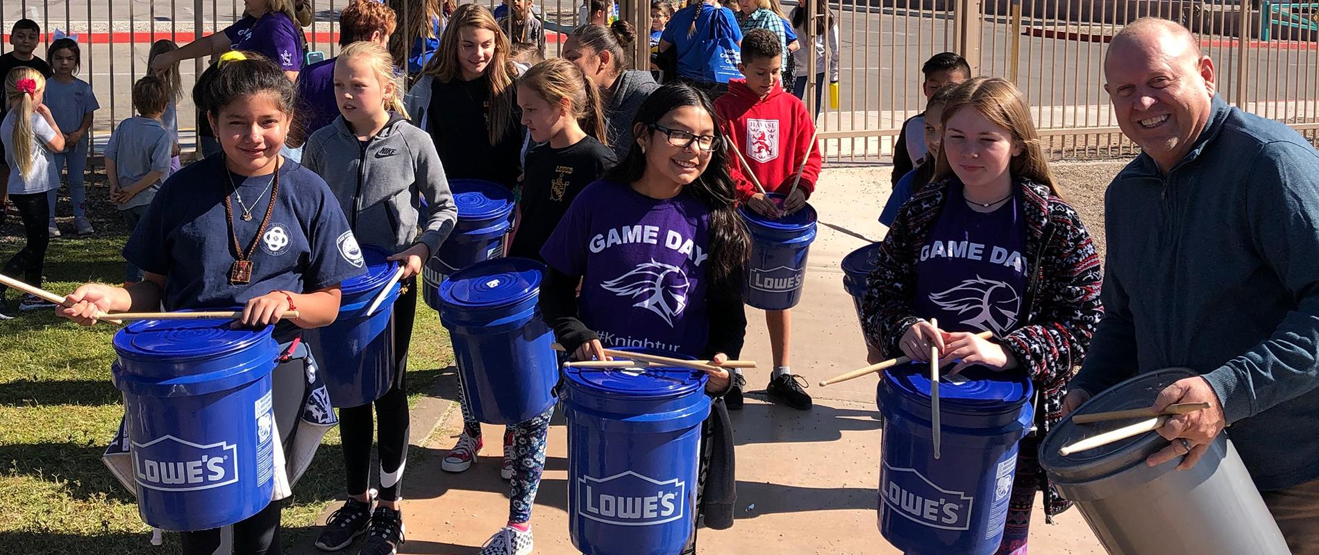 picture of students playing bucket drums