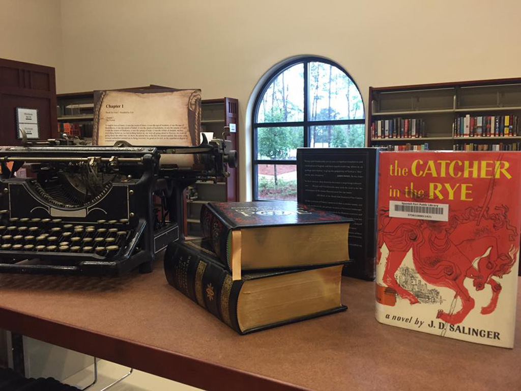 vintage typewriter and leather bound classic books on display shelf in Spanish Fort public Library