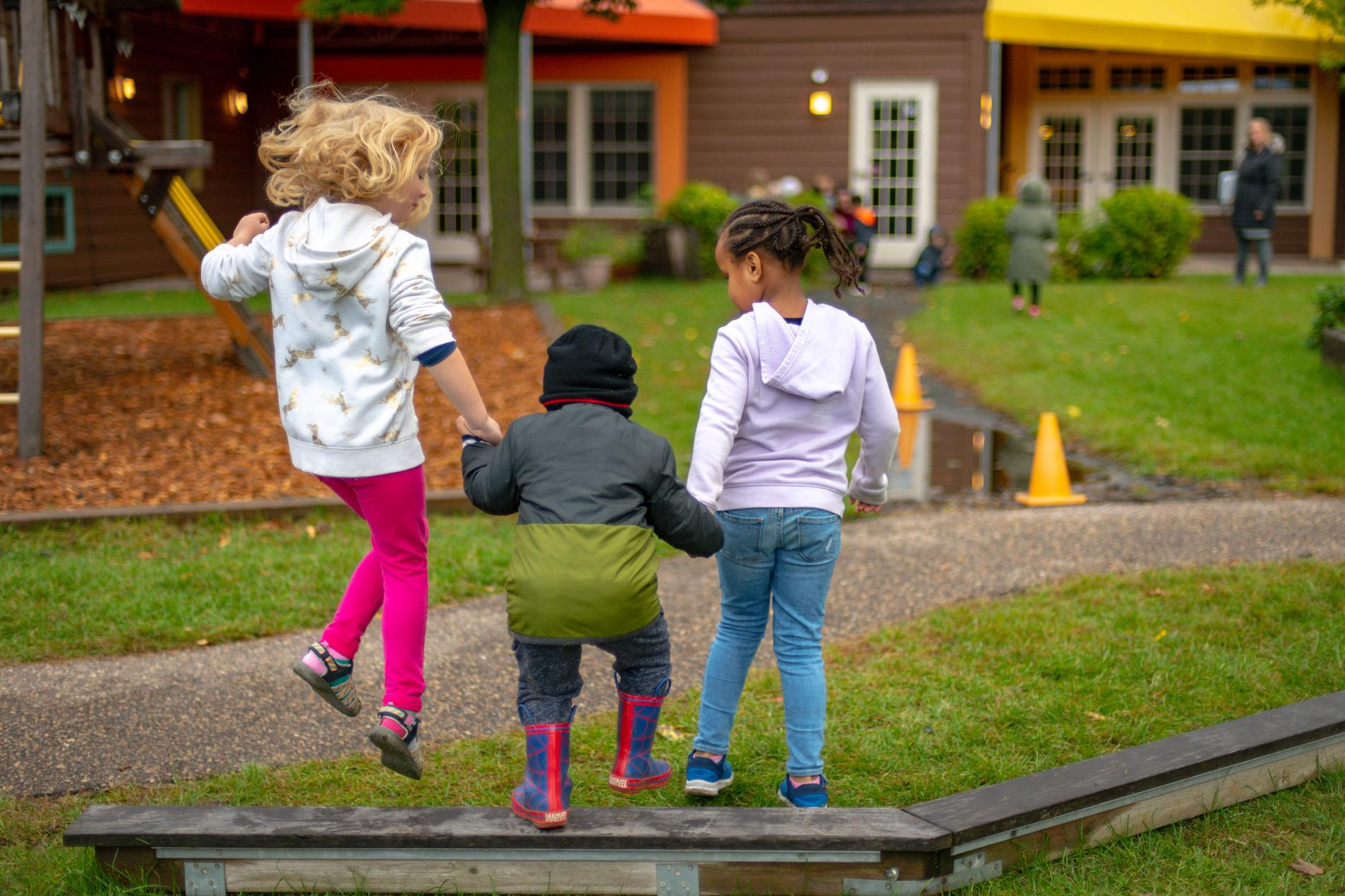 CH children outside jumping