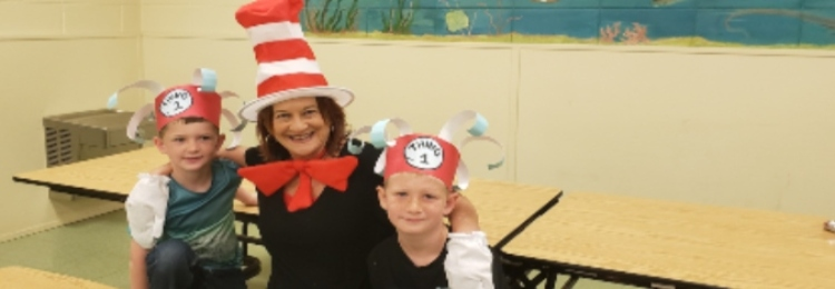 Person dressed as Cat in the Hat with students
