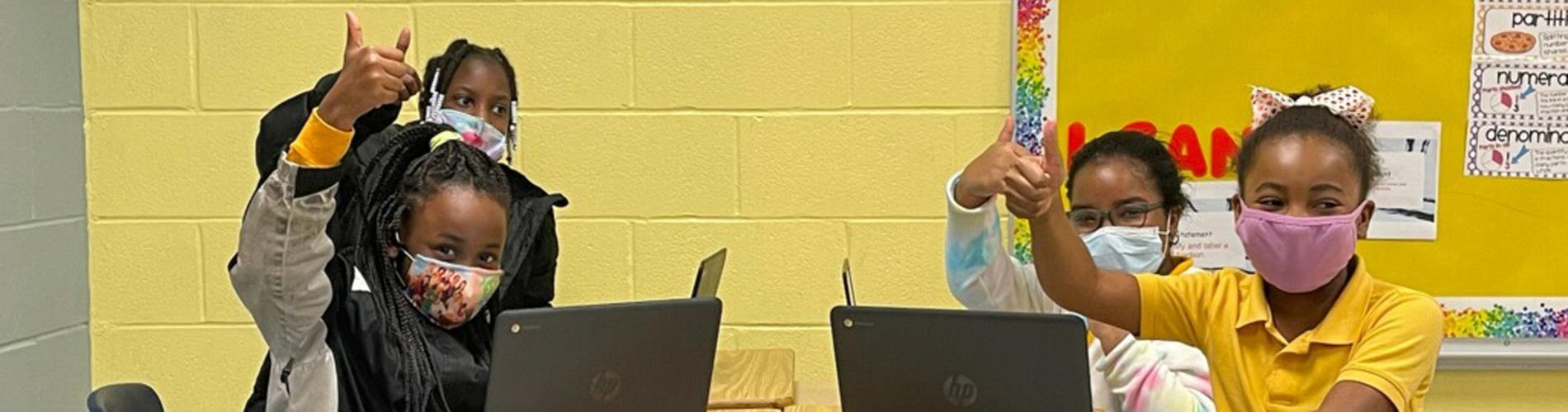 Students with their Chromebooks