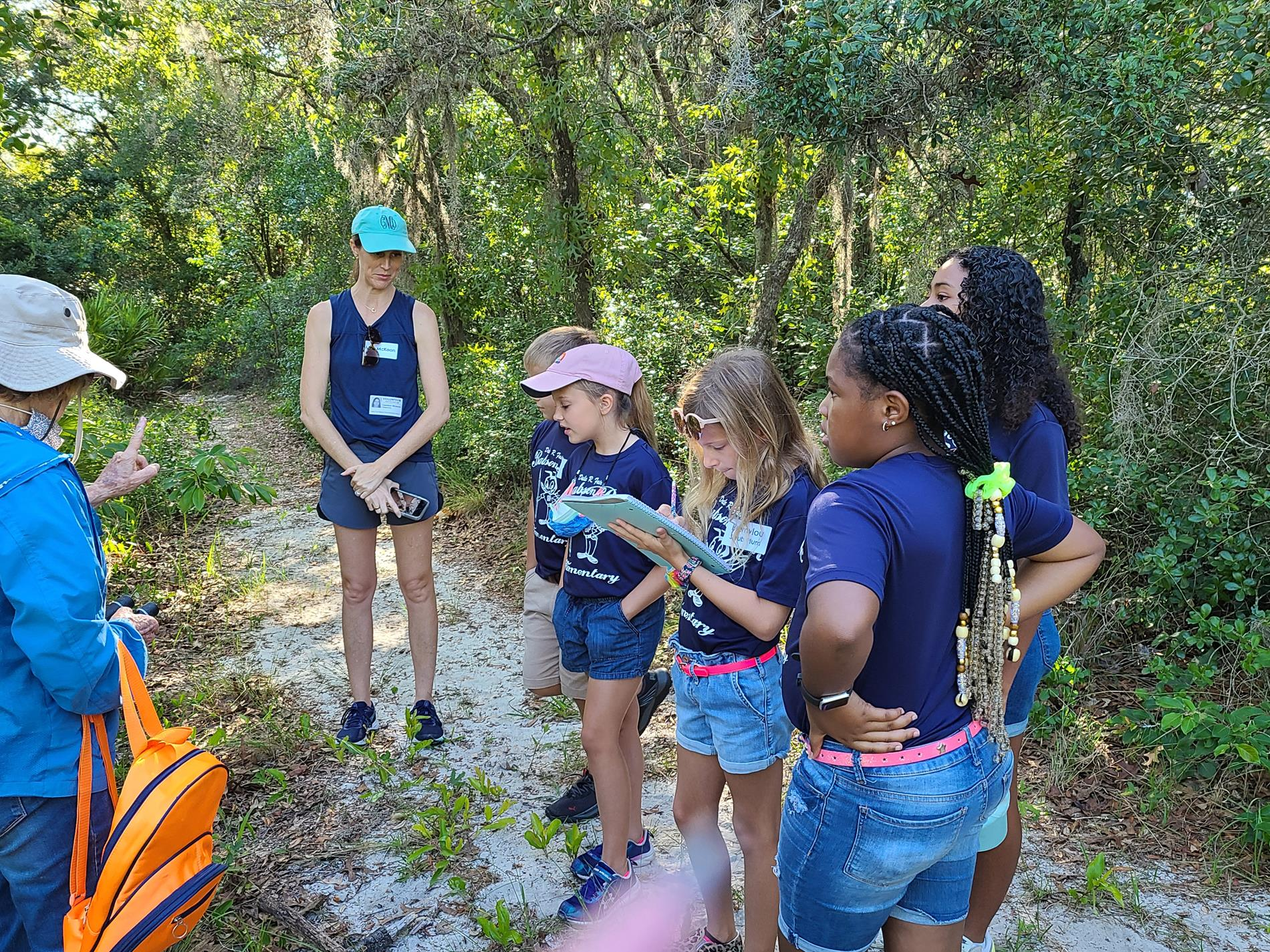 Mrs. Mercer's class listening to their trail guide.