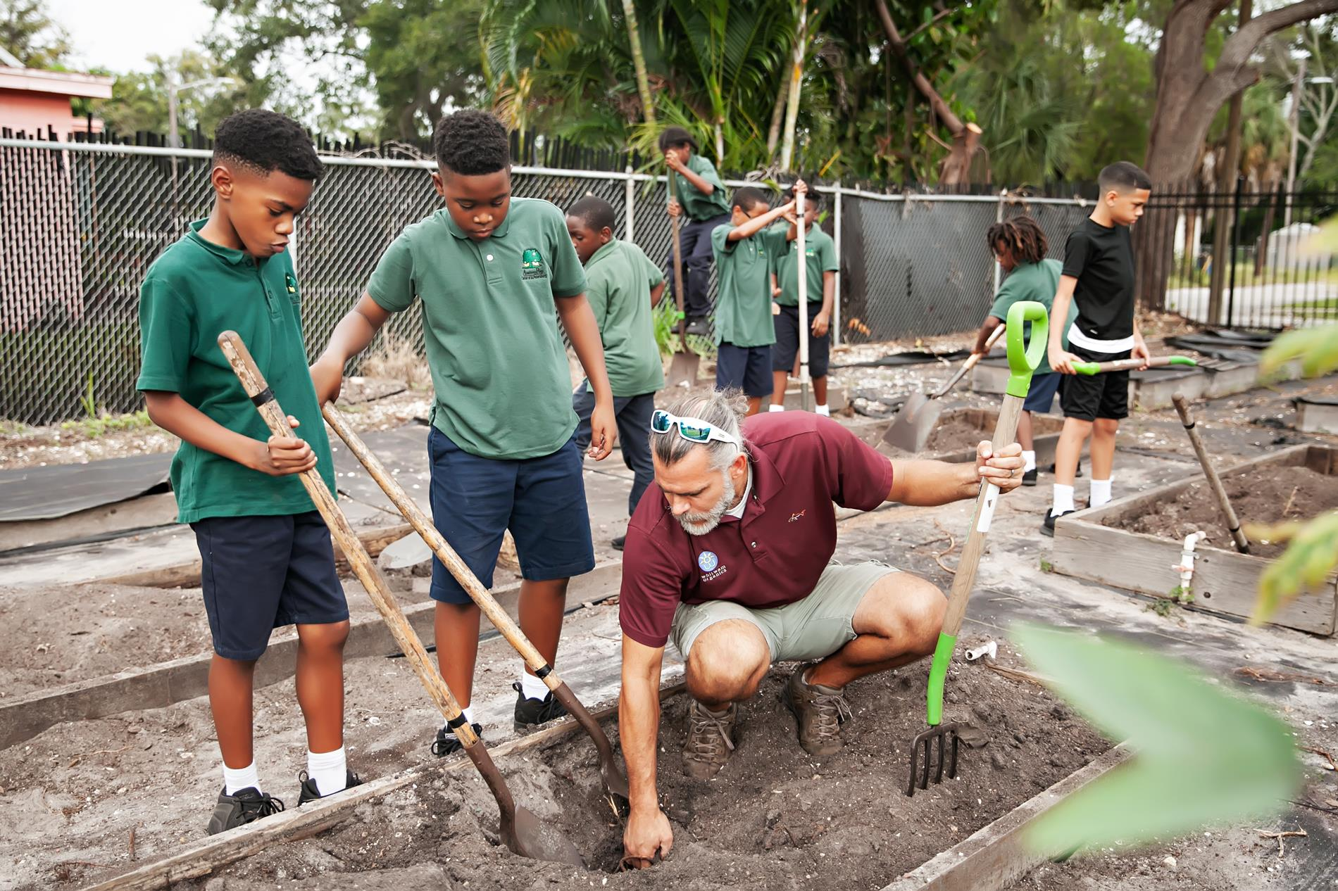 male students gardening