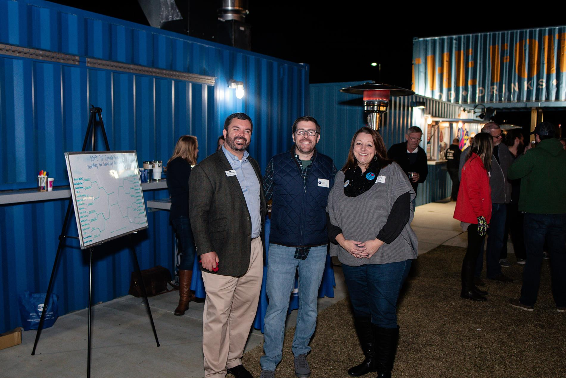 Frank Shepard, Eastern Shore Young Professionals, 3rd Annual ESYP Cornhole tournament participant, and Tracy M. Cole, Director of Spanish Fort Public Library at the 3rd annual Eastern Shore Young Professionals Cornhole Tournament library fundraiser, 11/20/19