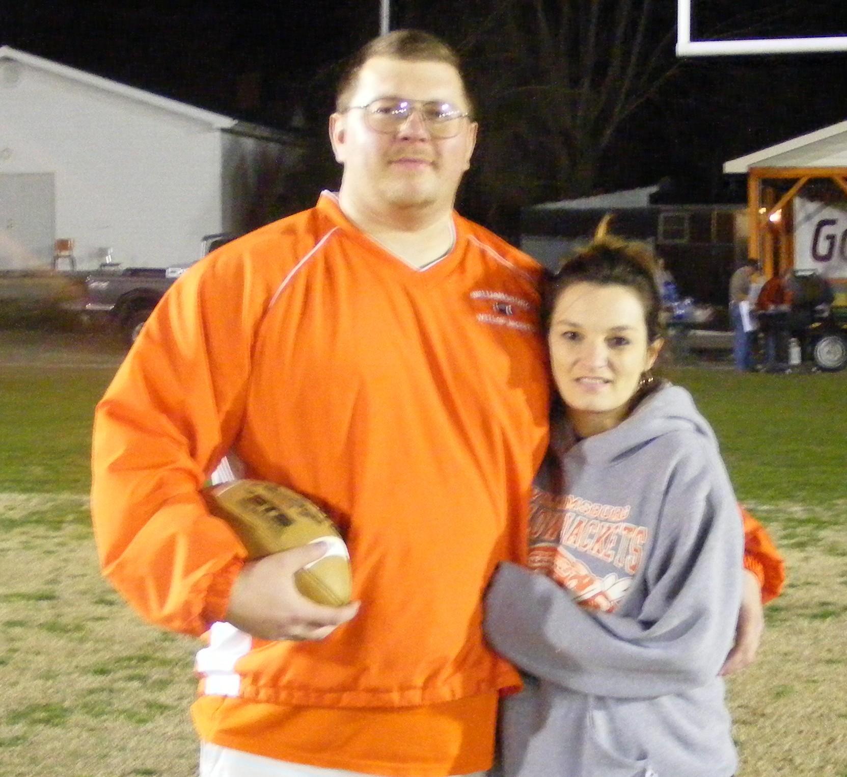 Coach Herron and Mrs. Herron at a football game