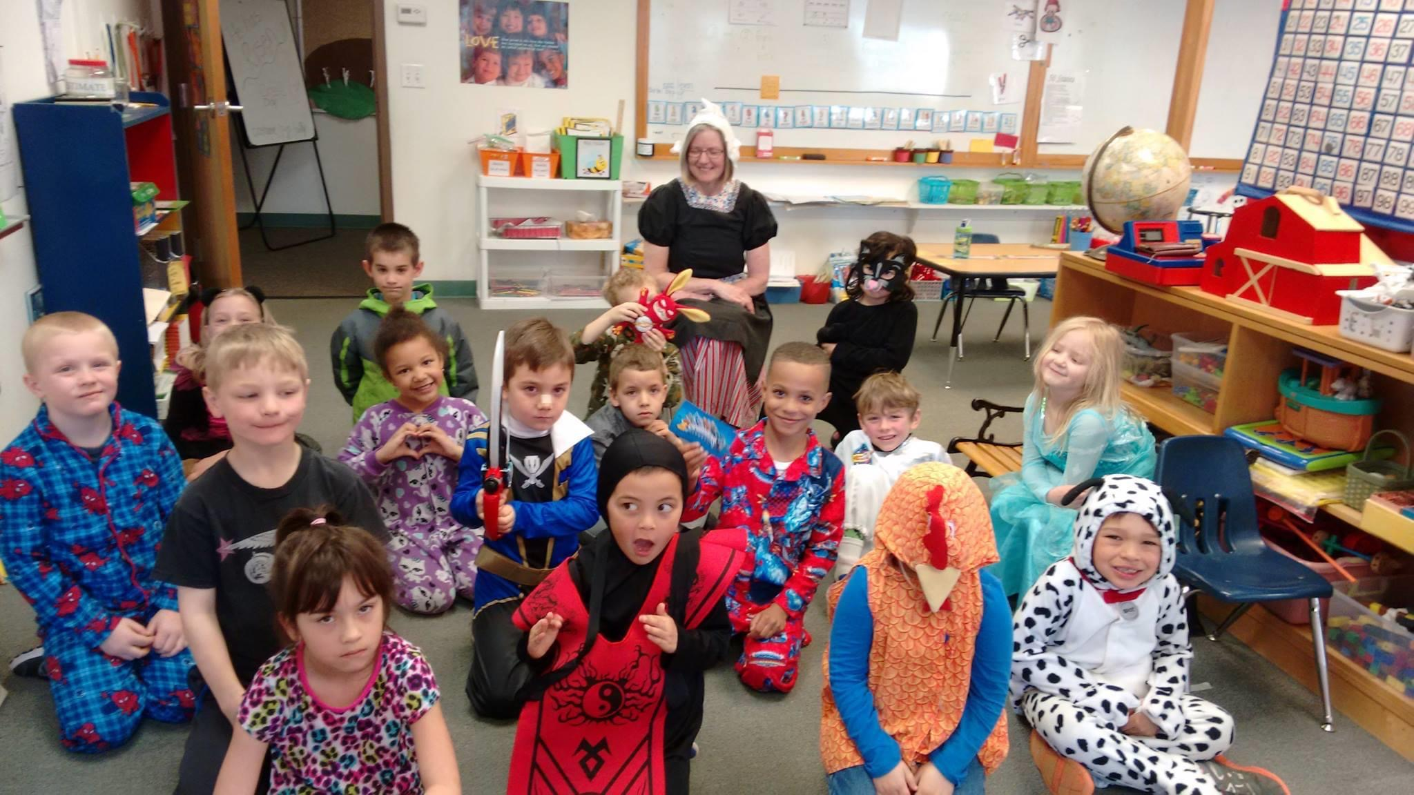Students reading in costumes