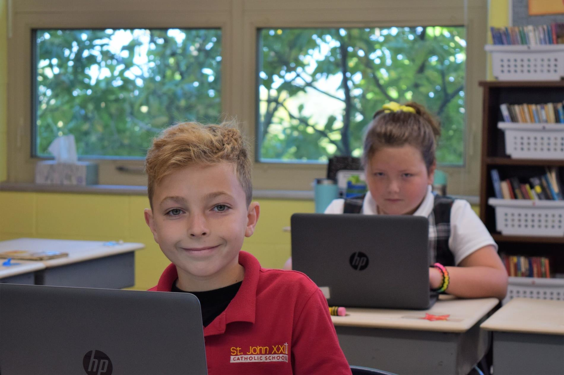 boy and girl at desk working on laptop
