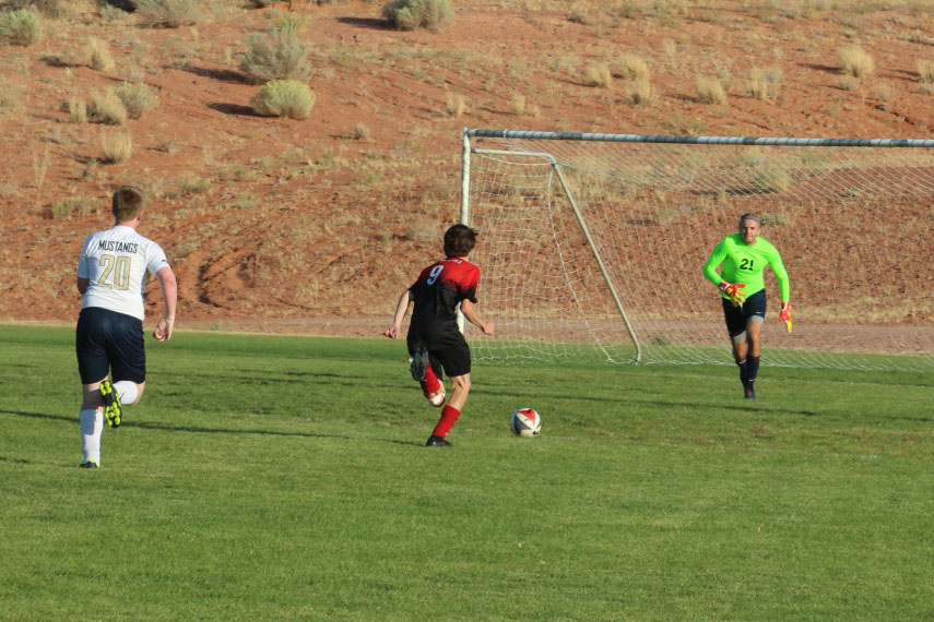 soccer player attacking the goal