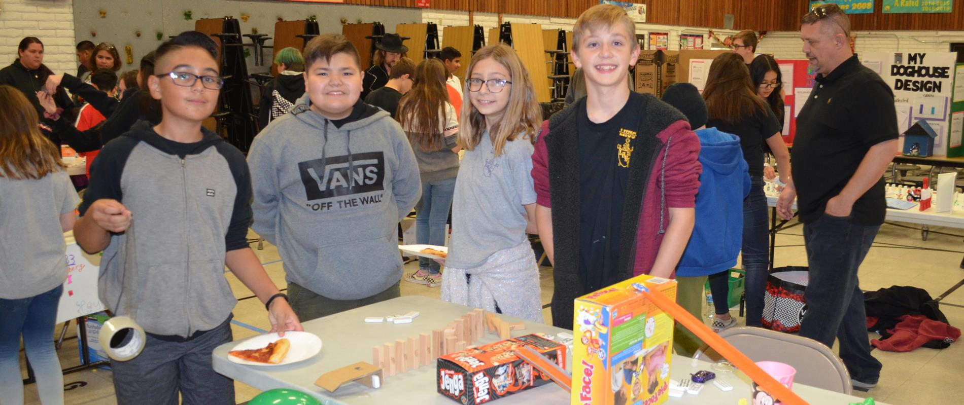 picture of students standing with their science fair project