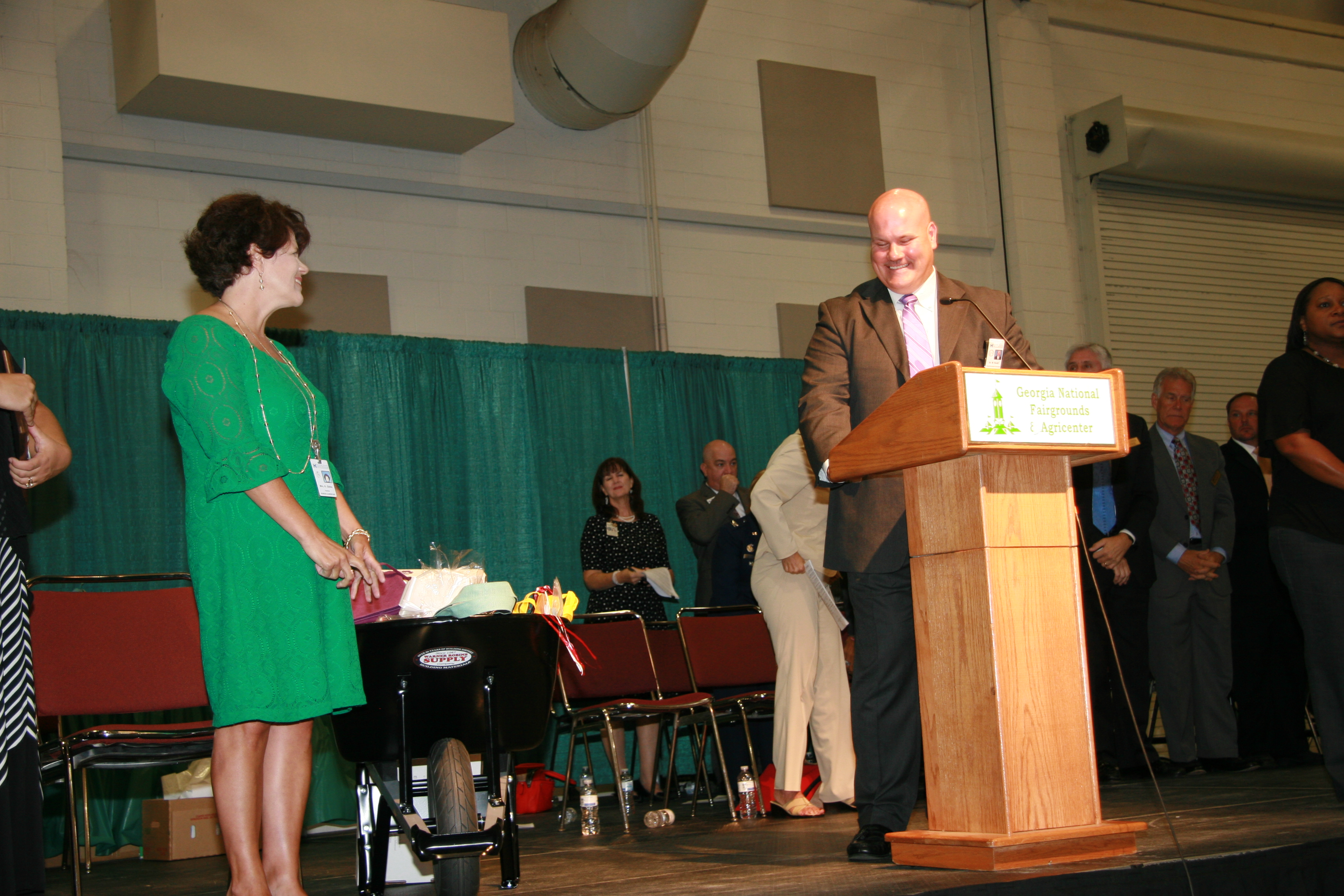 Superintendent of Schools Dr. Mark Scott congratulating Kathy Gibbs