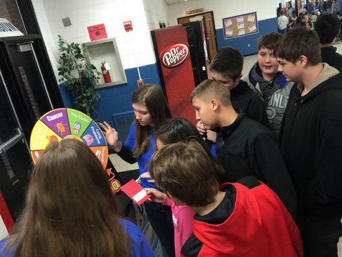 DMS students enjoying the SADD Club displays for Kick Butts Day.